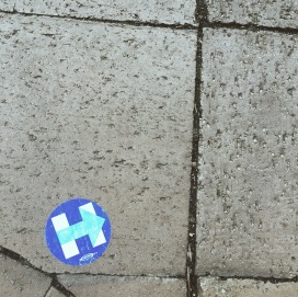 A Hillary Clinton sticker stuck to the sidewalk in Washington, D.C.