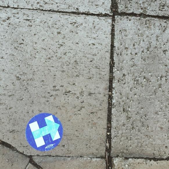 A Hillary Clinton sticker stuck to the sidewalk in Washington, D.C.